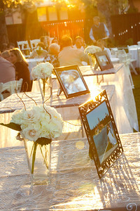 wedding tables with framed photos and flowers
